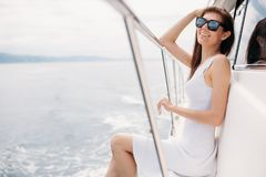 Caucasian female model in glasses posing on luxury sailing boat. Young beautiful female model wearing glasses dreaming on the deck of a yacht at Caribbean sea royalty free stock images