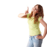Young and beautiful female pointing up Stock Images