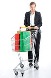 Young female pushing a shopping cart Stock Photography