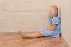 Young Beautiful Female Sitting on Floor Stock Photo