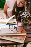 Young beautiful female sitting outside and studying hard. Royalty Free Stock Photo