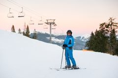 Young female on ski holiday in mountains looking at camera Royalty Free Stock Images