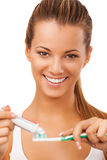 Young beautiful female, smiling, and preparing for brushing her teeth. Stock Photography