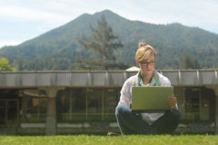 Young beautiful female student on campus Stock Photo