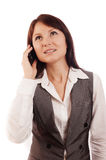 Business woman talking on cell phone. Young beautiful female talking on cell phone isolated on white Stock Image