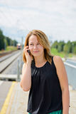 Young beautiful female talking on mobile phone Stock Image