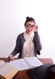 Young beautiful female teacher sitting at a table Stock Photography
