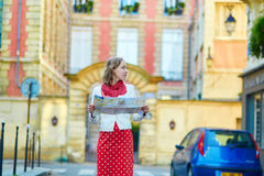 Young beautiful female tourist with map in Paris Royalty Free Stock Photography