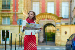 Young beautiful female tourist with map in Paris Royalty Free Stock Image