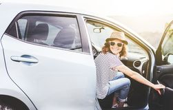 Young beautiful female travel girl in hat and sunglasses speaks royalty free stock photos