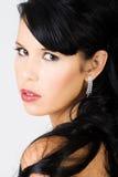 Young beautiful female wearing makeup stock image