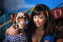 Young beautiful fisherwoman with Dalmatian Stock Image