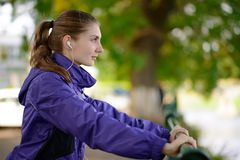 Young Beautiful Fit Woman Exercising in the Park Stock Photography
