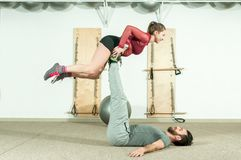 Young beautiful fitness couple workout extreme acrobatic exercise as preparation for the competition, selective focus Royalty Free Stock Photo