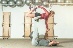 Young beautiful fitness couple workout extreme acrobatic exercise as preparation for the competition, selective focus Stock Images