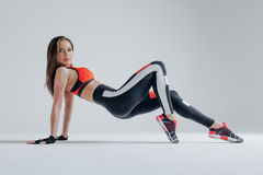 Young beautiful fitness female posing in studio stock photo