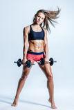 Young beautiful fitness female posing in studio Royalty Free Stock Photo