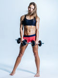 Young beautiful fitness female posing in studio Royalty Free Stock Photography