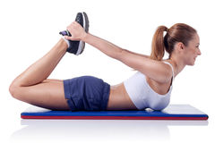 Young beautiful fitness girl doing exercise isolated on white Royalty Free Stock Photos