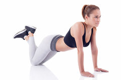 Young beautiful fitness girl doing exercise isolated on white Stock Images