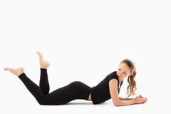 Young beautiful fitness girl exercising in gym Royalty Free Stock Photos
