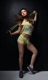 Young beautiful fitness sport woman with the jump rope posing Royalty Free Stock Image