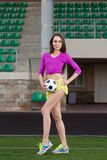 Young and beautiful fitness woman posing on playing field Royalty Free Stock Photos