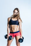 Young beautiful fitness woman posing in studio Stock Photo