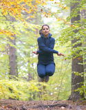 Young beautiful fitness woman skipping rope in forest Royalty Free Stock Photo