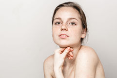 Young beautiful freckles woman face portrait with healthy skin Royalty Free Stock Image