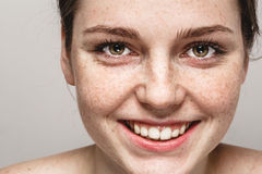 Young beautiful freckles woman face portrait with healthy skin Stock Images