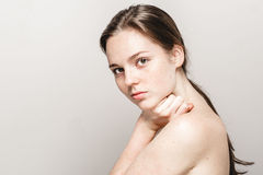 Young beautiful freckles woman face portrait with healthy skin Royalty Free Stock Images