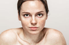 Young beautiful freckles woman face portrait with healthy skin Stock Image