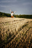 Young beautiful free happy woman jumps happy with smile Royalty Free Stock Photo