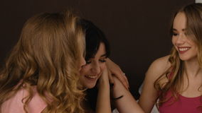 Young beautiful friends entrusting their secrets in the bedroom. slow motion stock video footage