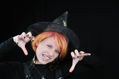 Young beautiful furious halloween witch Royalty Free Stock Photography