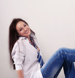 Young beautiful girl. Is sitting on the floor Stock Image
