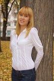 Young beautiful girl. In an autumn park Stock Photos