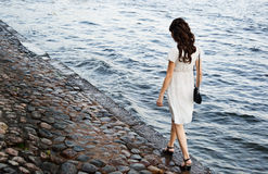 Young beautiful girl. On water background Royalty Free Stock Images