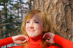The young beautiful girl. In a wood stands near a tree Stock Images