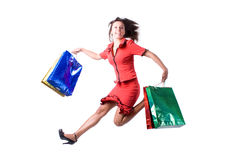 The young beautiful girl. With purchases in colour packages during shopping on a white background Stock Photo