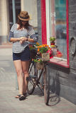 Young beautiful girl with aged bicycle. Photo of young beautiful girl with aged bicycle Stock Images