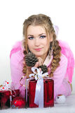 The young beautiful girl an angel. With gifts Stock Photo
