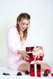 The young beautiful girl an angel. With gifts Stock Images
