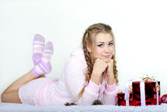 The young beautiful girl an angel. With gifts Stock Image