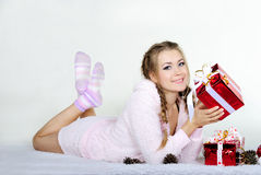 The young beautiful girl an angel. With gifts Royalty Free Stock Images