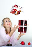 The young beautiful girl an angel. With gifts Royalty Free Stock Photo