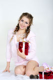 The young beautiful girl an angel. With gifts Royalty Free Stock Photos