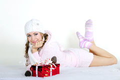 The young beautiful girl an angel. With gifts Royalty Free Stock Image