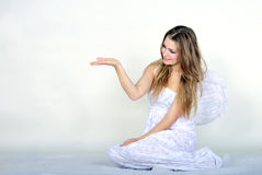 The young beautiful girl an angel with wings. On a white background Royalty Free Stock Photo